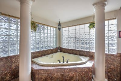 Master Tub with glass block natural lighting