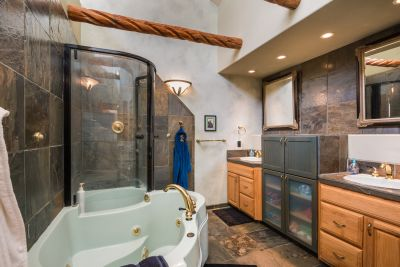 Downstairs Full Bathroom with storage and natural lighting