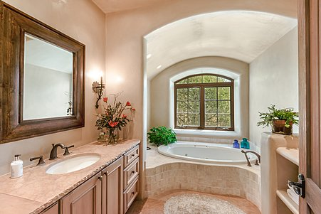 Owners' Suite contains Separate Rooms for Garden Tub...