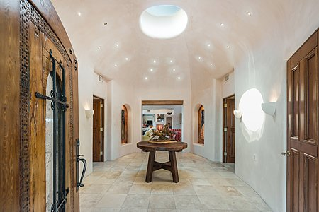 High Plastered Dome Ceiling with Pinlights gives a Rotunda Feel to the Entry Foyer