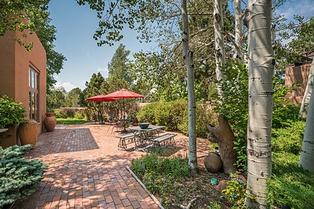 Beautifully Landscaped Gardens are accessed from the Living and Dining Rooms...