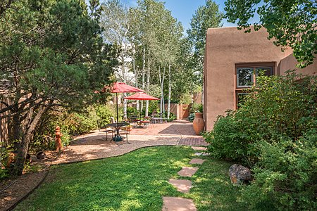 Park-like Setting surrounds the Residence on this Corner Lot