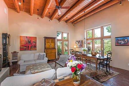 Living Room with Tall Ceiling has Large Windows overlooking the Walled Gardens...