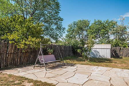Side yard with flagstone patio and shed