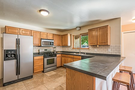 Kitchen with stainless appliances and ample counter space