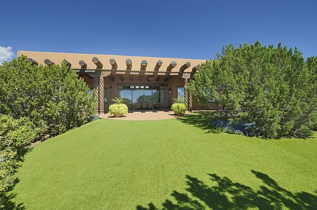 Elegant landscaped backyard overlooks the Second Fairway of the Jack Nicklaus Signature Sunrise golf course