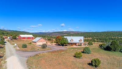 Aerial view of homesite & outbuildings looking west
