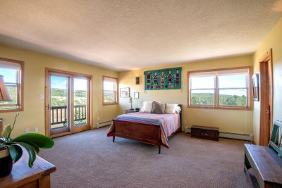Master bedroom suite with exterior patio