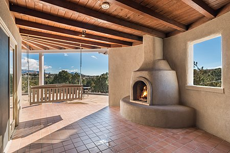 Side portal with kiva fireplace and fabulous view!