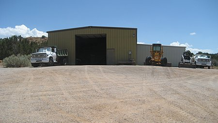 Equipment barn by the cattle pens and entrance