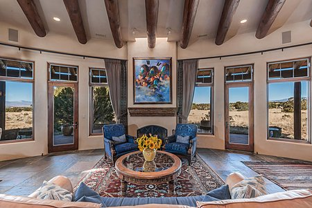 Great Room with Large Fireplace and East-to-West Mountain Views