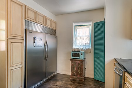 Catering refrigerator in Kitchen of Adobe home.