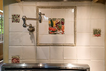 Hand made Tile details with pot filling faucet over stove.