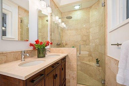 Travertine Tiled Shower in Owner's Suite Bathroom