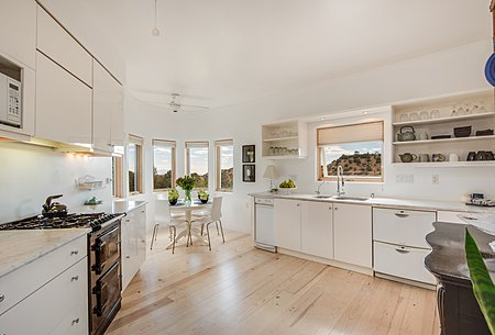 Chic Contemporary Kitchen with High Gloss White Cabinetry