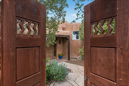 Wooden doors open to Entry Courtyard