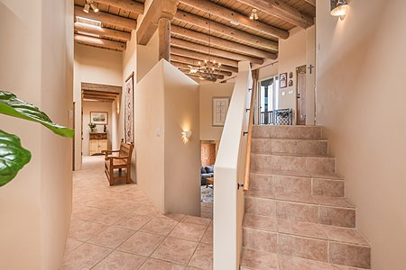 From entry foyer stairs lead up to Great Room and Kitchen