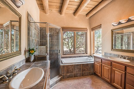 Master Bathroom enjoys 2 sinks, soaking tub and separate shower stall