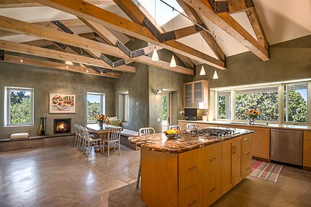 Chef's Kitchen has Pigmented Plaster Walls and Vaulted Ceiling