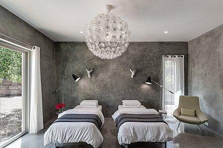 Bedroom of Second Guest Suite has Sliding Door to Rear Courtyard...