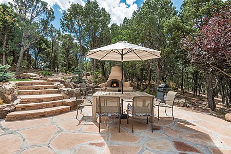 Flagstone patio in front of main house