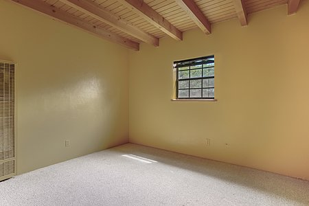 Second bedroom with beam ceilings