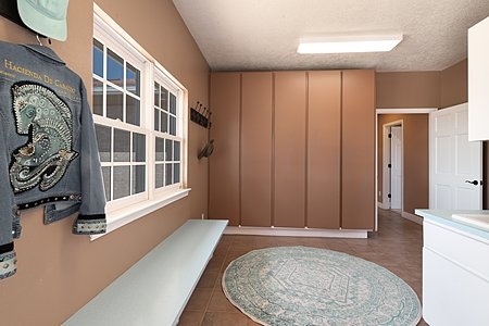 Large Mud Room with Storage for each Bedroom