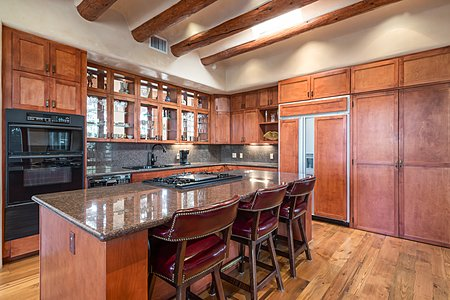 Kitchen with Shaker style cabinetry and wood floors