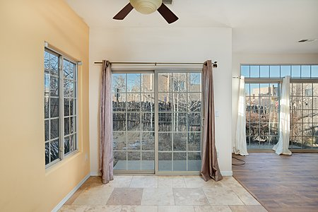 Sliding glass doors in dining area open to small patio
