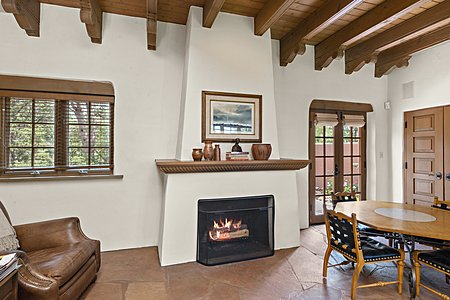 ...that has a Wood-burning Fireplace with Hand-carved Mantel...