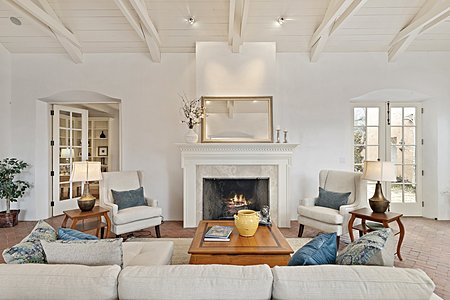 ...centers on a Beautiful Fireplace with Dental Molding...