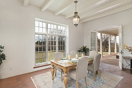 The Dining Room is framed by French Doors and Large Windows...
