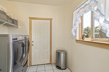 Laundry Room off Kitchen / Door to Enclosed Back Portal
