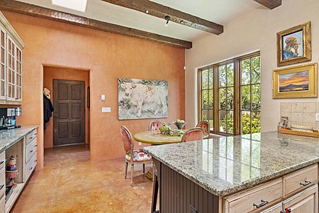 The Breakfast Area adjoins the Kitchen and Overlooks the Entry Courtyard