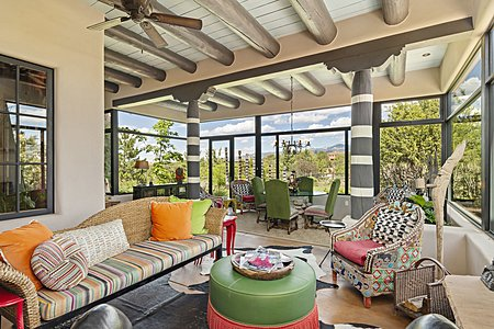 The Sun Room has Walls of Windows to take in the Mountain Views