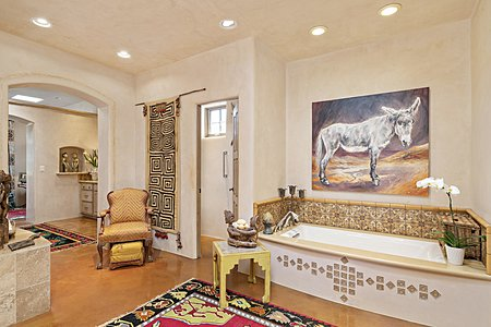 The Owner's Bath is a Suite onto Itself with a Soaking Tub and a Walk-in Shower...