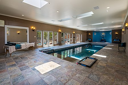 Indoor Lap Pool opens to Fenced Patio