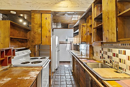 Galley Kitchen with handmade Tile back splash by Helen Bacigalupa