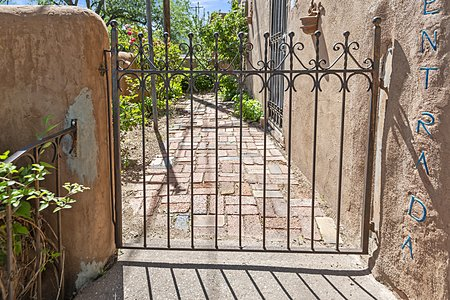 Front gate iron work into courtyard