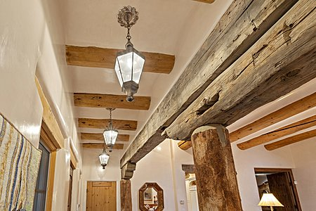 Hallway to Secondary Bedrooms with Rustic Beams and Columns
