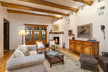 Great Room with Impressive Fireplace and French Door to Back Portal