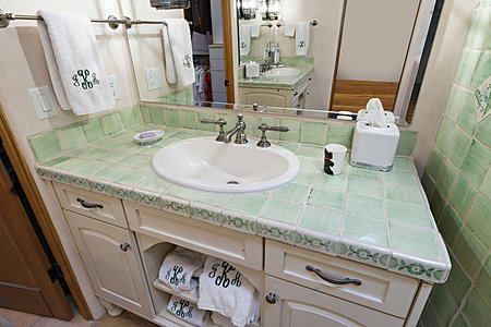 One Master Sink with the other one shown in the Mirror