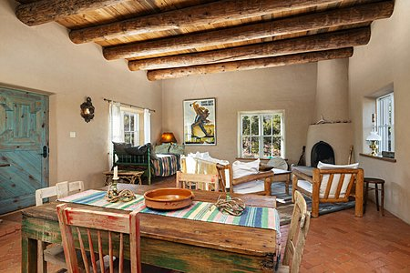 Guest house dinning and sitting area with a kiva fireplace to keep you warm at night