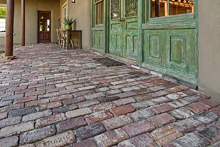 Custom bricks and doors of interior courtyard at Main house
