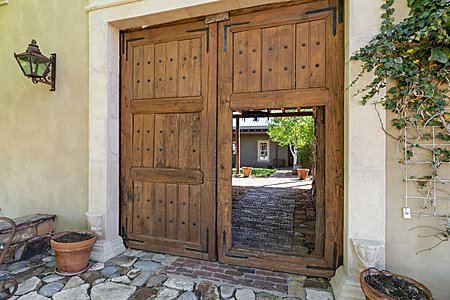 Custom doors leading to Main house courtyard