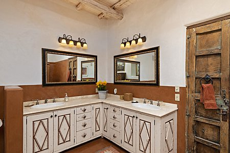 Custom built cabinets with dual sinks in the master bathroom