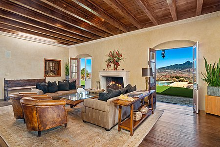 Double doors of the Sala lead to the back patio with breathtaking views of Cerro Pedernal