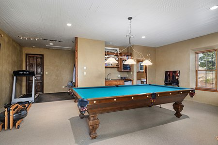 The carriage house is used as entertaining space with a full bathroom and two car garage
