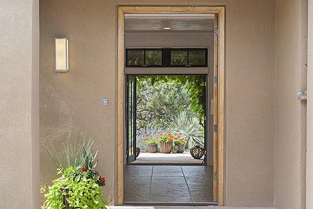 Open front door looking through to open covered portal in back