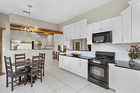 The Bright Kitchen is open to the Family Room...